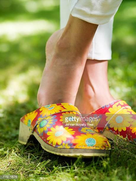 Woman wearing flowery clogs Stockholm Sweden.