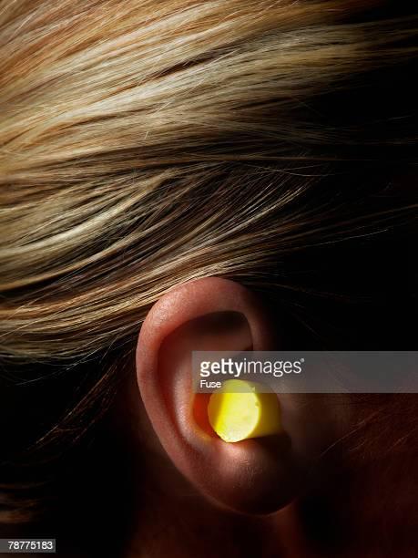 Woman Wearing Foam Earplug in Ear
