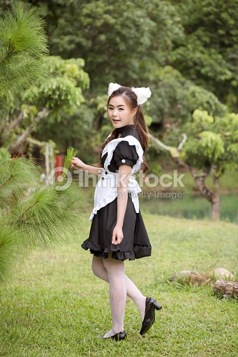woman wearing french maid costume with cat ears stock photo thinkstock