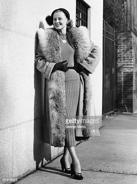 Woman wearing fur coat posing outdoors, (B&W), (Portrait)