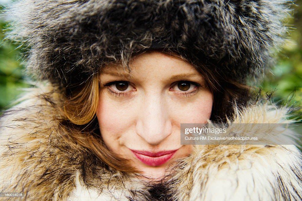 Woman wearing fur outdoors : Stock Photo