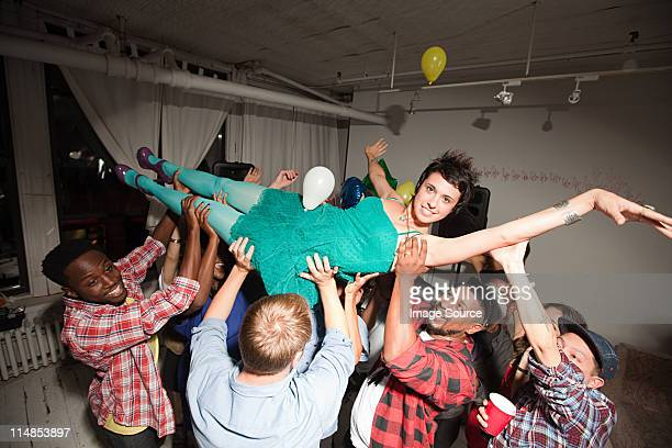 Woman wearing green dress at party crow surfing
