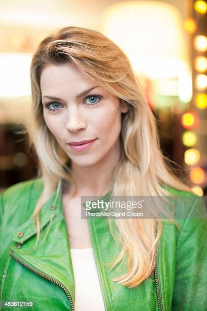 Woman wearing green leather jacket, portrait