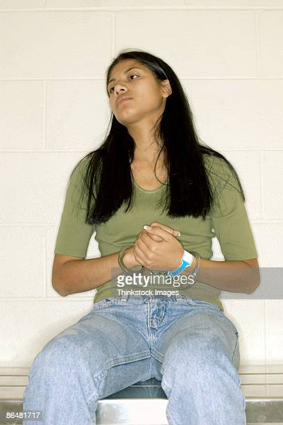 Woman wearing handcuffs