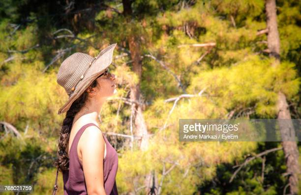 Woman Wearing Hat Against Trees