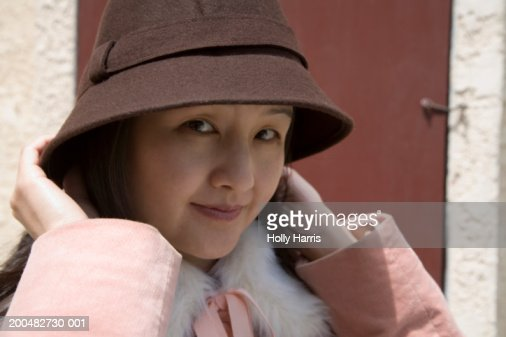 Woman wearing hat and pink coat : Stock Photo