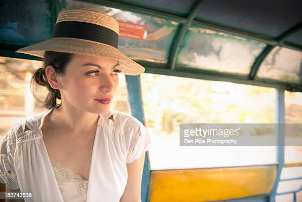 Woman wearing hat on rickshaw