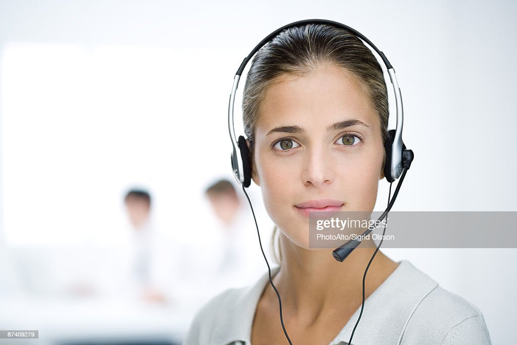Woman wearing headset, looking at camera, portrait