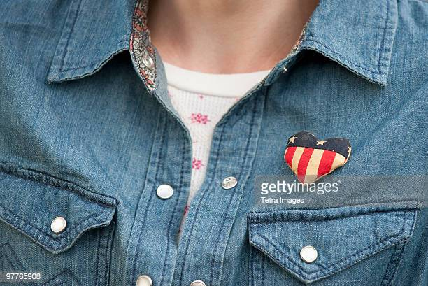 Woman wearing heart pin
