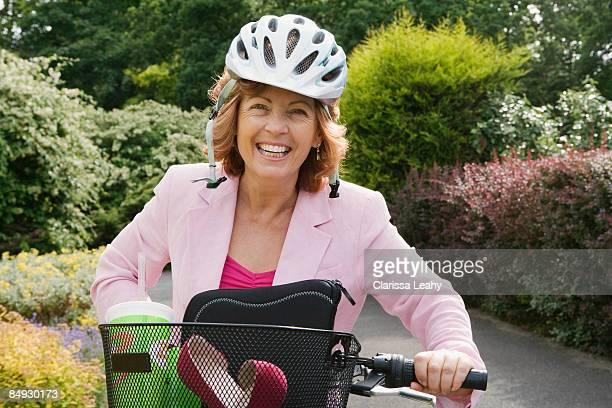 Woman wearing helmet on bicycle