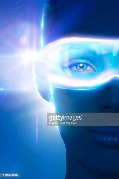 woman wearing hologram eye piece that glows