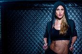 Woman wearing hoodie in gym