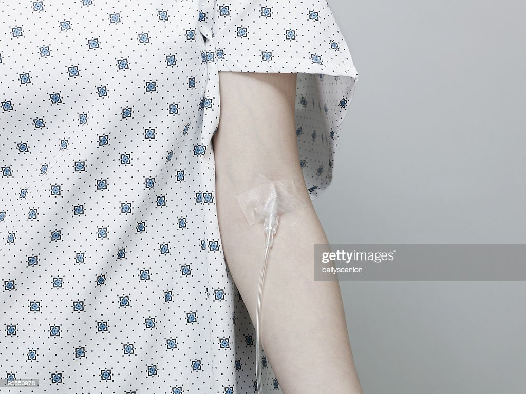 Woman Wearing Hospital Gown with Intravenous Drip. : Stock Photo