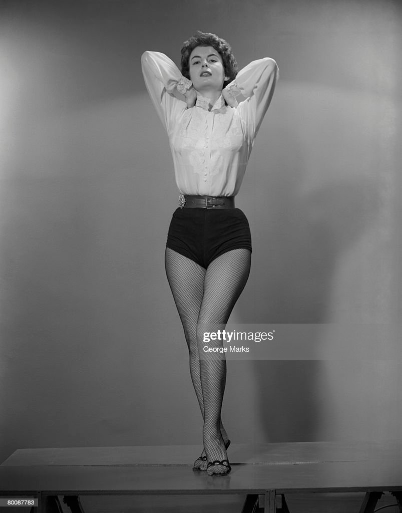 Woman wearing hot pants and stockings, portrait