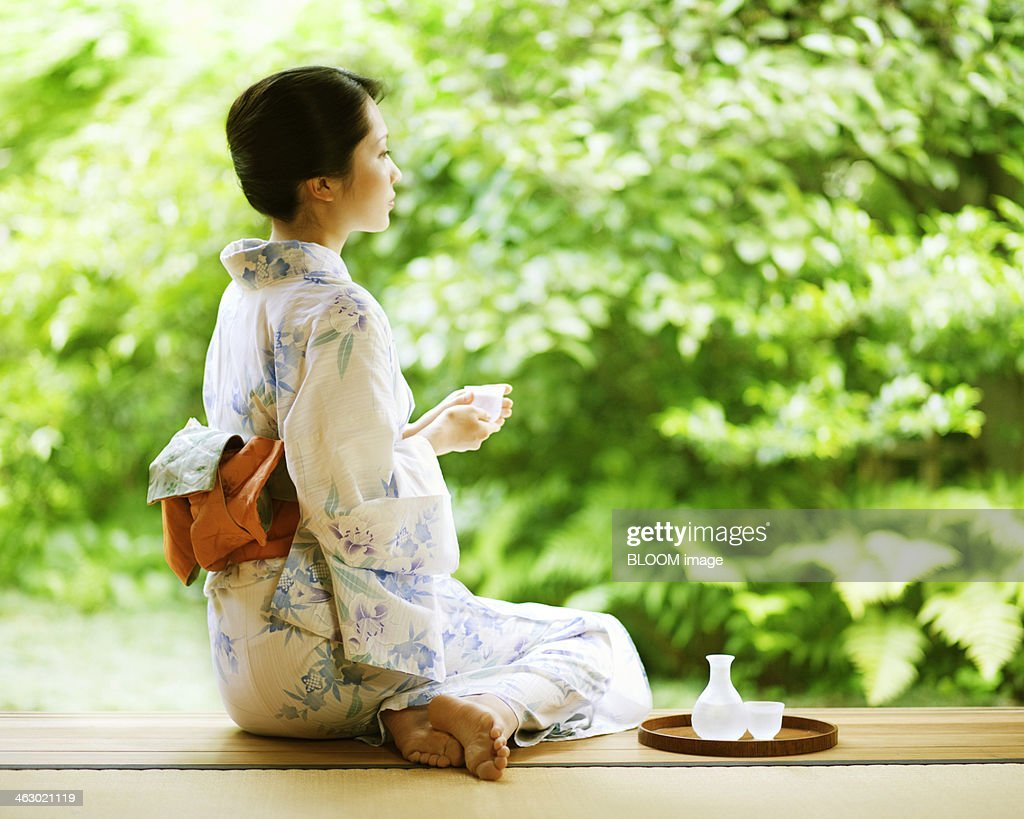 Woman Wearing Kimono Sitting On Veranda
