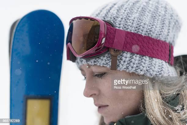 Woman wearing knit hat, close up