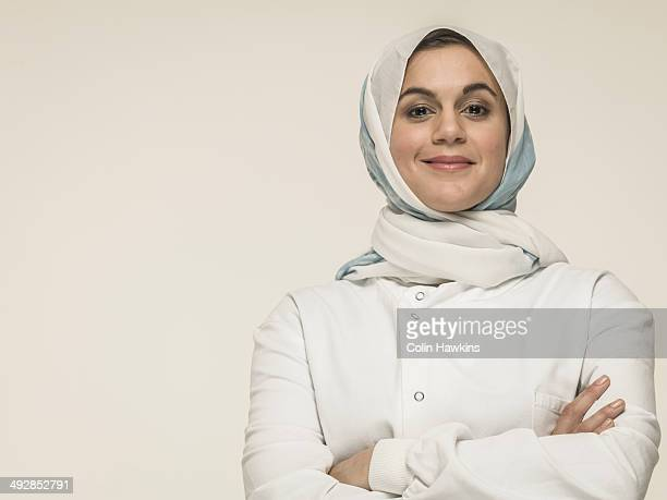 Woman wearing laboratory coat and hijab head scarf