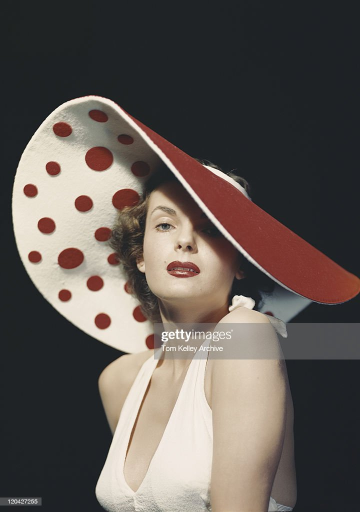 Woman wearing large spotted hat, portrait : Stock Photo