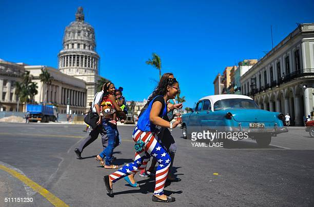 A woman wearing leggings with the colours of the US flag walks along a street of Havana on February 18 2015 President Barack Obama announced Thursday...