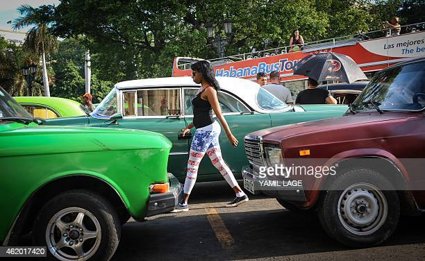 A woman wearing leggings with the US flag design walks in Havana on January 23 2015 Hours into historic USCuba talks in Havana a Cuban official came...