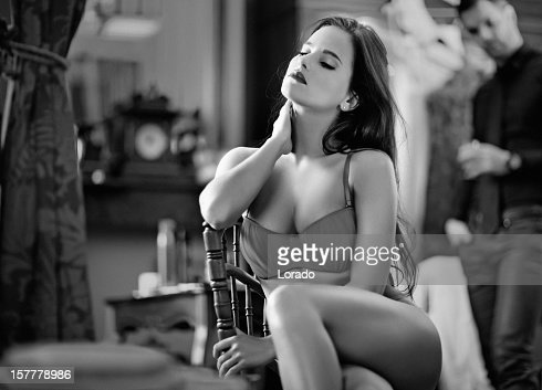 woman wearing lingerie posing indoors : Stock Photo