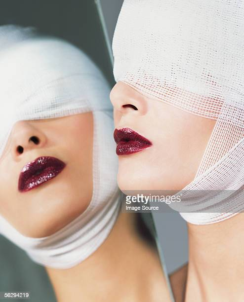Woman wearing lipstick and bandages
