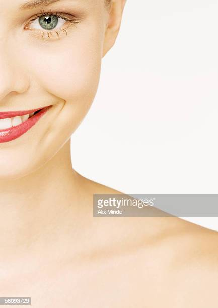 Woman wearing lipstick, partial view of face and shoulder