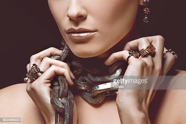 woman wearing luxury jewellery and heavy iron chain