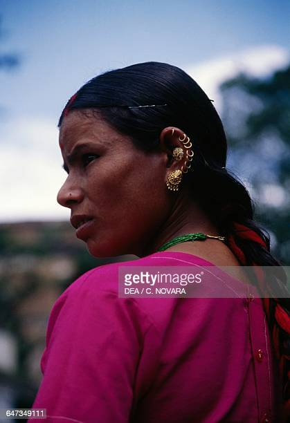 Woman wearing many earrings Pashupatinath Temple Mandsaur India