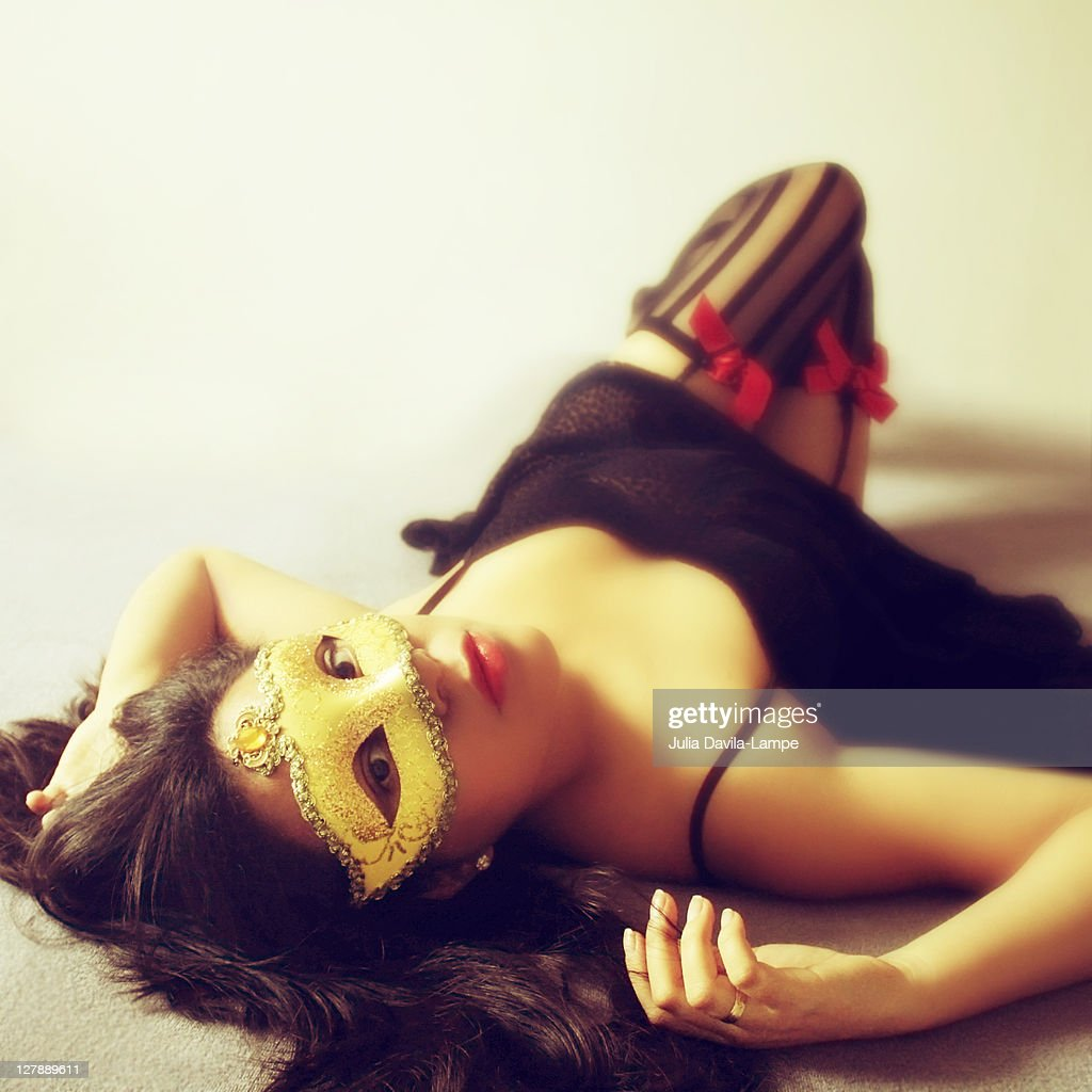 Woman wearing mask : Stock Photo