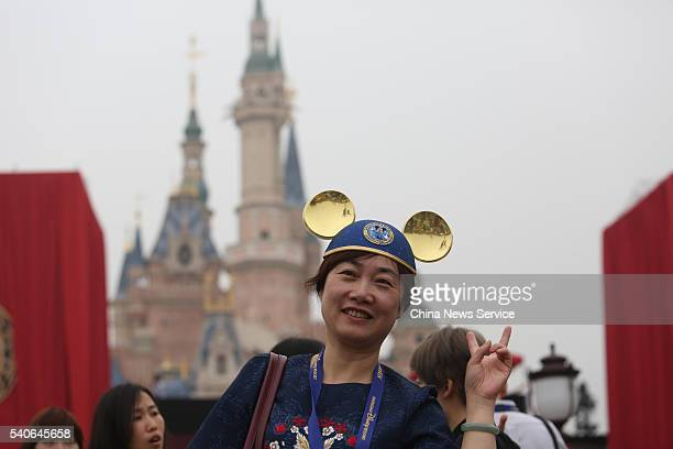 A woman wearing Mickey Mouse ears poses during the opening ceremony at Shanghai Disney Resort on June 16 2016 in Shanghai China Shanghai Disney...