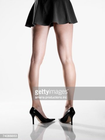 wearing mini skirt and high heels stock photo