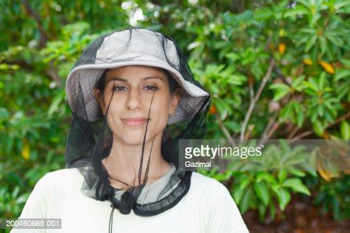 Woman wearing mosquito net, portrait