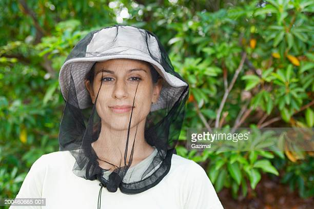 Woman wearing mosquito net, portrait