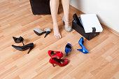 Woman wearing on high heel shoes