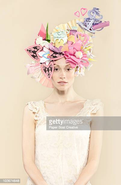 woman wearing paper hat with hearts and candy