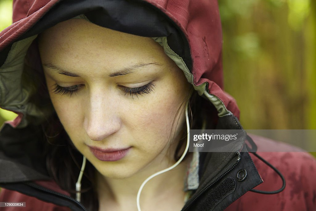 Woman wearing parka and headphones : Stock Photo