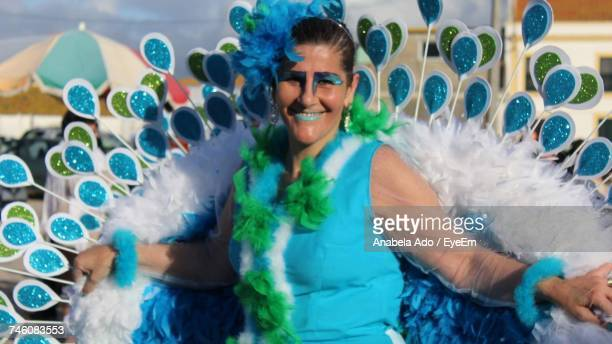 Woman Wearing Peacock Costume During Festival
