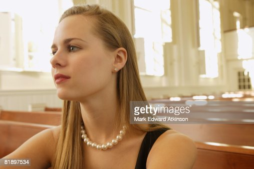 Woman wearing pearl necklace in church