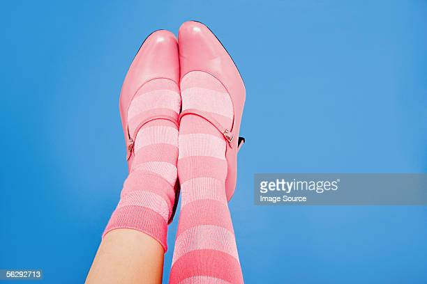 Woman wearing pink socks and shoes