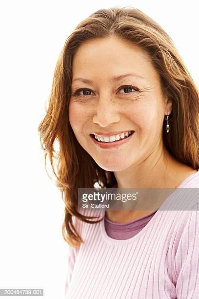 Woman wearing pink top, smiling
