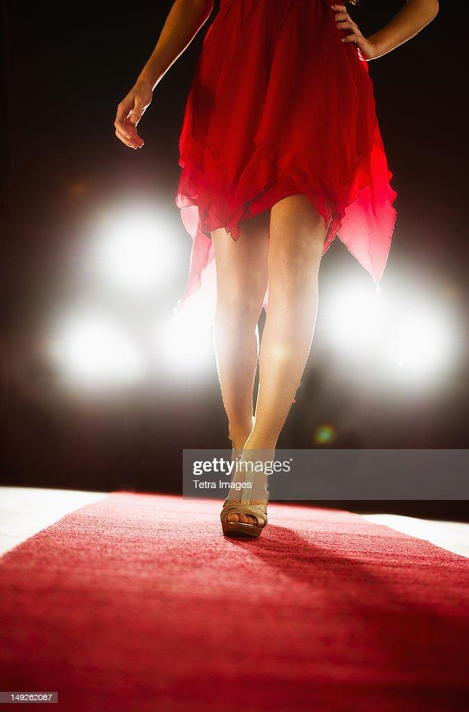 Woman wearing red dress on catwalk