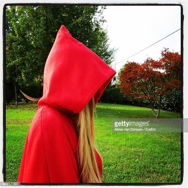 Woman Wearing Red Hooded Cape