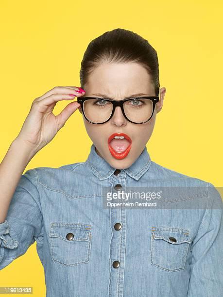 Woman wearing retro glasses and denim shirt