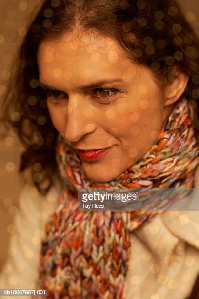 Woman wearing scarf, close up