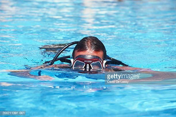 Woman wearing scuba mask