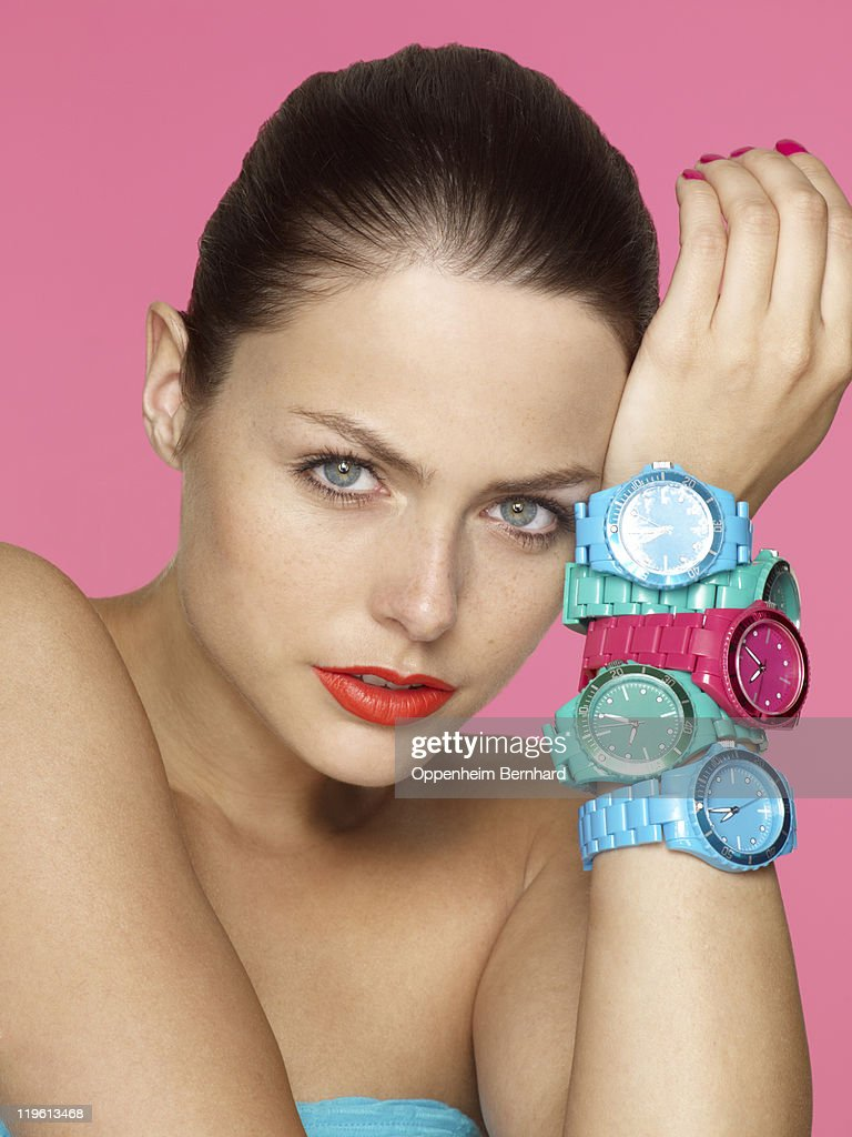 Woman wearing several watches