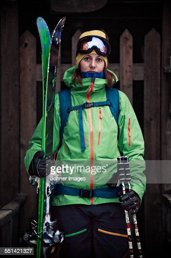 Woman wearing ski clothes looking at camera