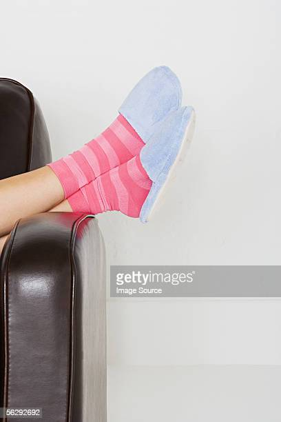Woman wearing slippers and striped socks