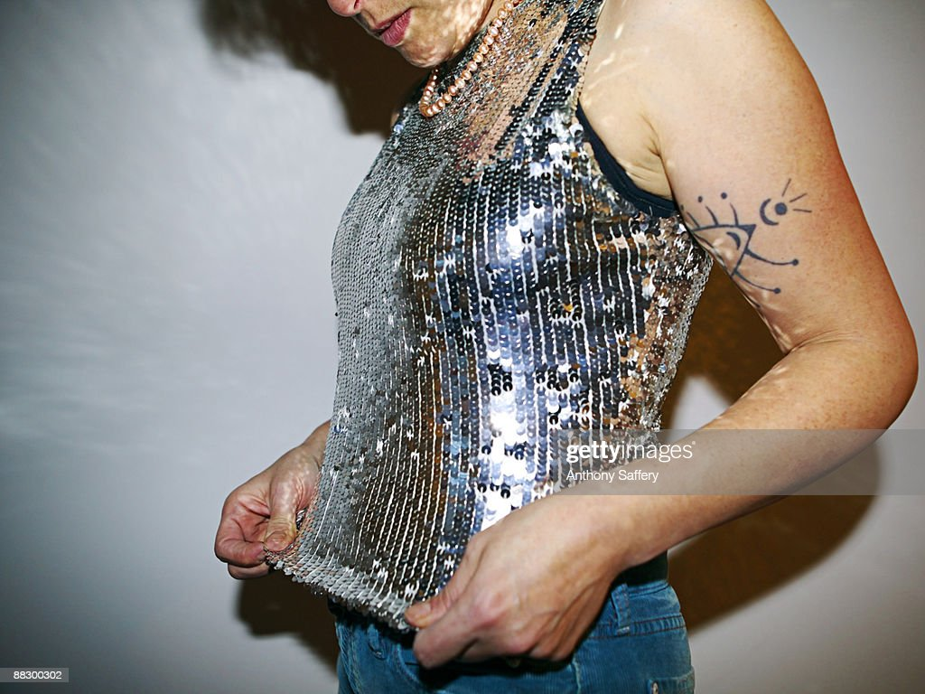 Woman wearing sparkling sequined camisole